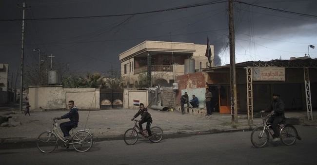 The Latest: Baghdad bombings kill 14, wound 50