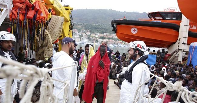 EU softens line on refugee quotas