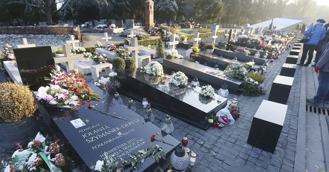 Poland exhumes president, wife killed in 2010 plane crash