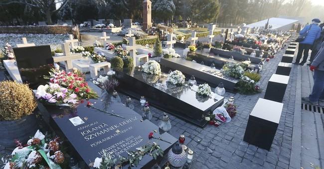 Poland exhumes president, wife killed in 2010 plane crash