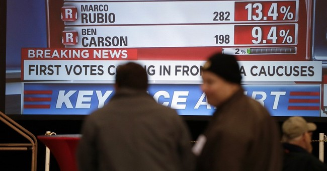 The Latest: Some Iowa precincts resort to coin flips