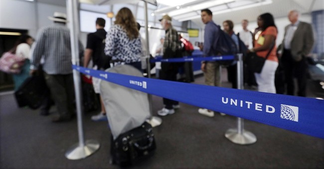 United lets families board early, reversing 4-year policy