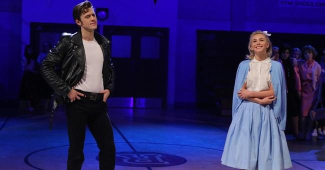 'Grease' fights through rain, tragedy to reach 12.2 million