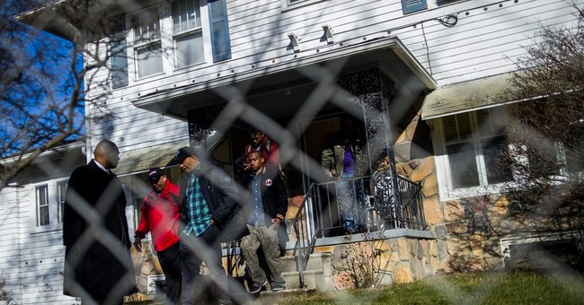 The Latest: Music mogul Russell Simmons offers hand in Flint