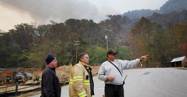 The Latest: TVA bans burning in 7 states amid drought, fire