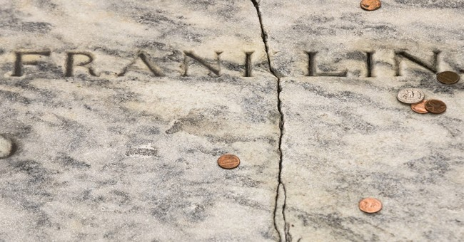 Benjamin Franklin's gravestone develops crack from pennies