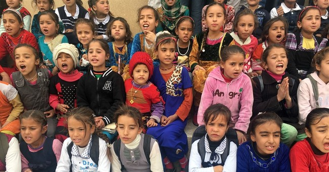 Iraqi children return to school in village freed of IS group