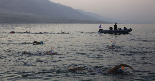 Swimmers complete 7-hour crawl across shrinking Dead Sea