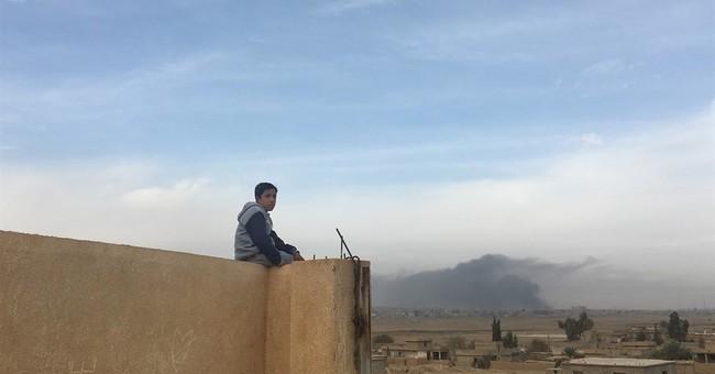 The Latest: Iraqi Shiite militia pushes deeper west of Mosul