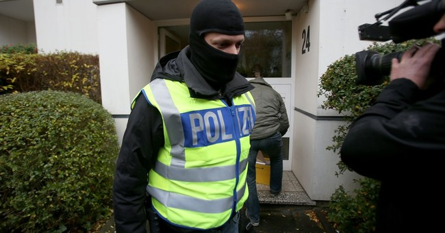 Germany bans Islamic organization, police search 190 sites