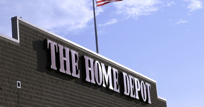 Home Depot raises outlook as Americans spend on homes