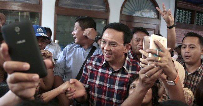 Indonesia police name Jakarta governor as blasphemy suspect