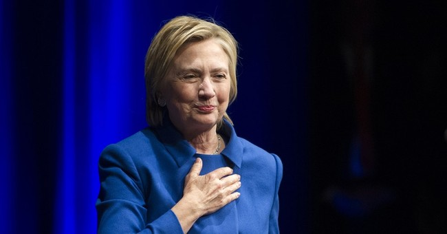 Clinton reflects on loss, urges backers to 'stay engaged'
