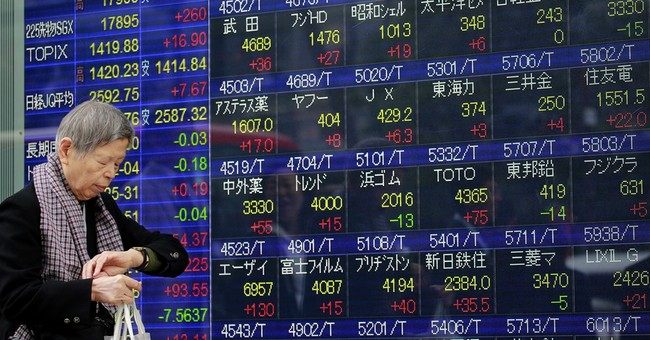 Global stocks mixed, awaiting more detail from Trump
