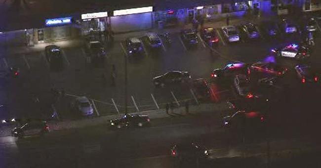 Police: Pizza shop customer shoots 2 robbers, killing 1