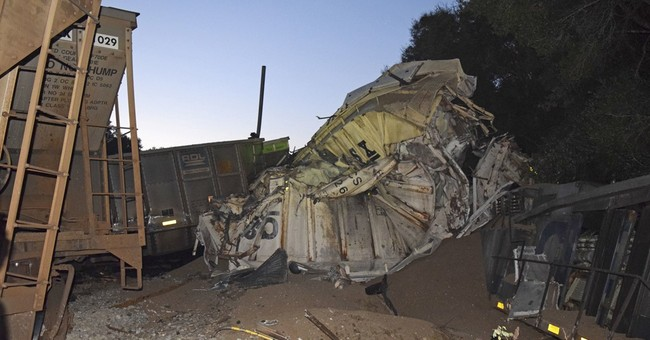 Train collision in Florida injures 2, mangles rail cars