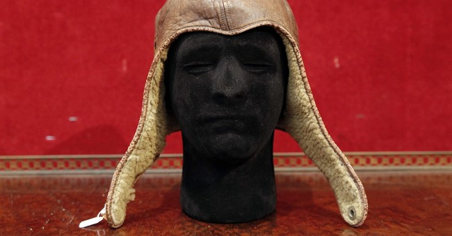 Lindbergh's iconic aviator cap goes unsold at Paris auction