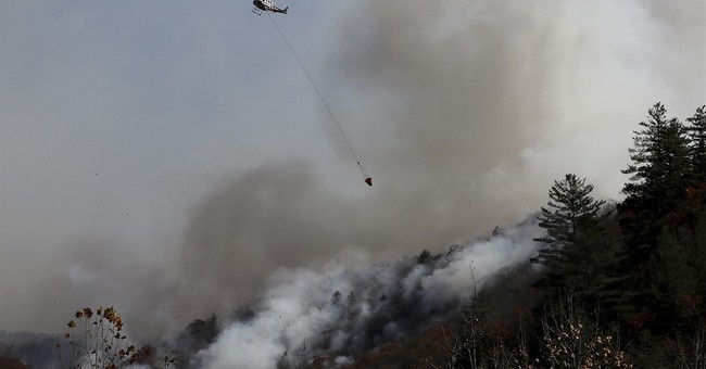 The Latest: Governor offers reward in North Carolina fires
