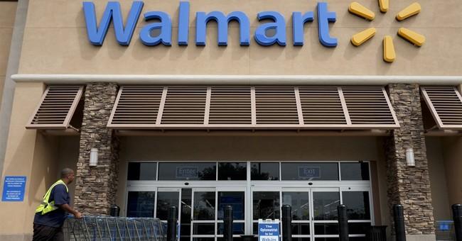 Wal-Mart's profit falls but beats estimates; revenue misses