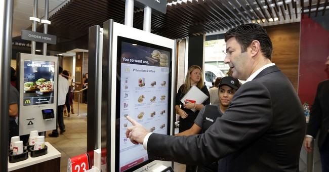 You deserve a seat today: McDonald's expanding table service