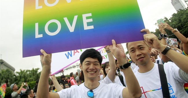 Taiwanese protest for, against same-sex marriage bill