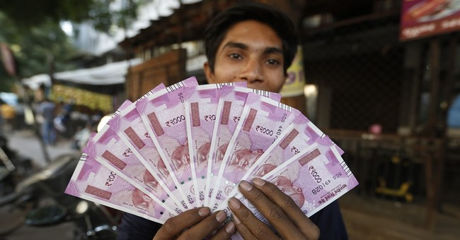 "The effects of India's currency reform? ""Chaos"" say analysts"