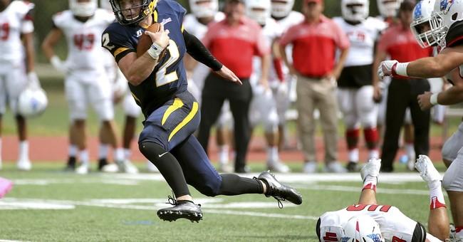 College quarterback runs down purse snatcher and tackles him