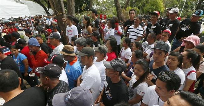Kin gather at Philippine dictator Marcos' tomb amid protests