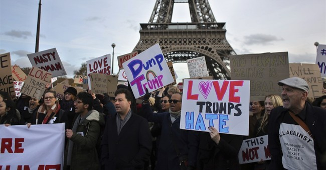 Hundreds of people protest against Trump in French capital