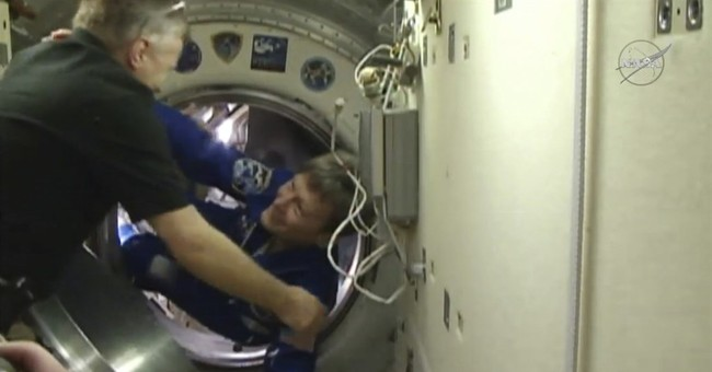 Space station receives oldest female astronaut, bit of Mars