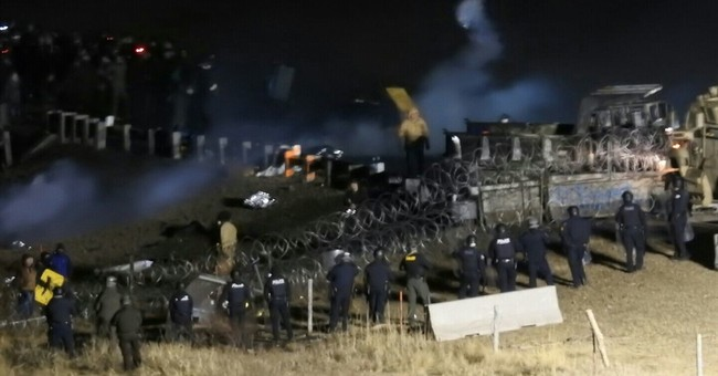 The Latest: Threat of another pipeline protest clash eases