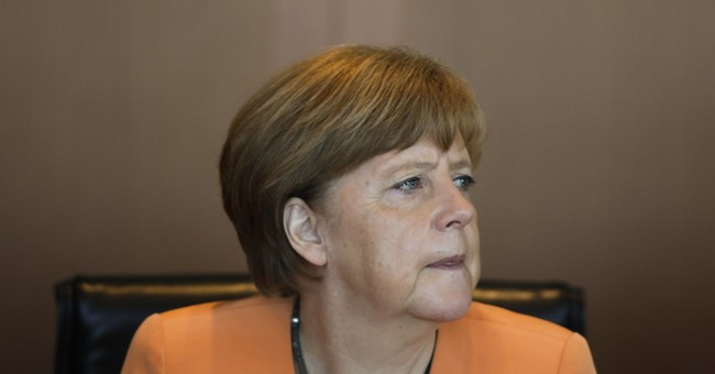 AP PHOTOS:  Merkel opens weekly cabinet meetings colorfully