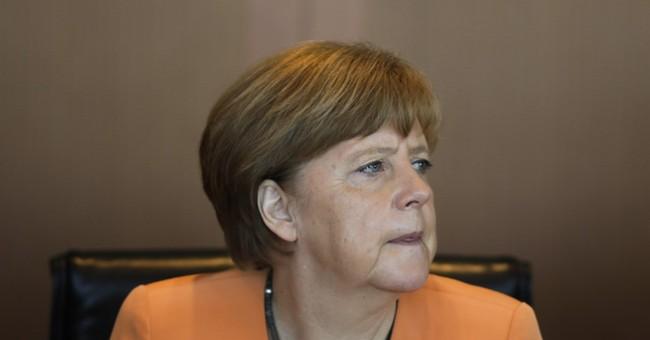 AP PHOTOS:  Merkel opens weekly cabinet meetings colorfully