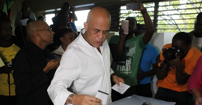 Haiti's presidential redo goes well; long vote count begins