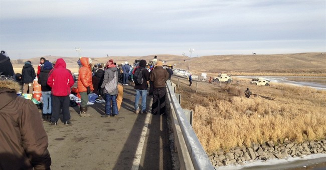 Officers douse pipeline protesters in subfreezing weather