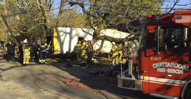 The Latest: Bus driver arrested in fatal school bus crash