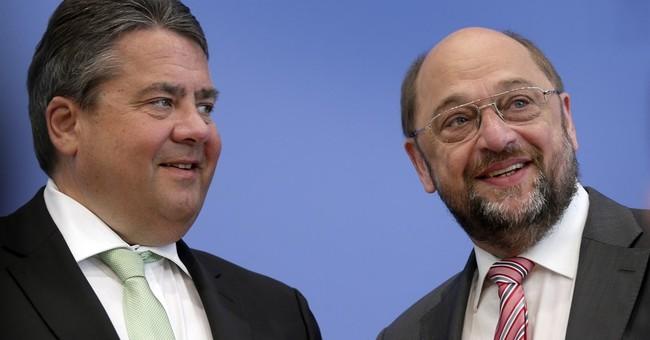Merkel's center-left rivals face pressure to name challenger