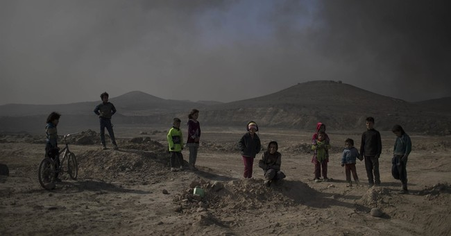 Iraqis finally put out some oil fires set months ago by IS