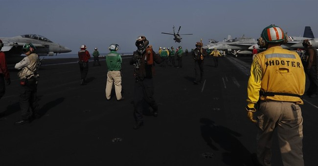 Planes launched off US carrier in Gulf pound IS militants