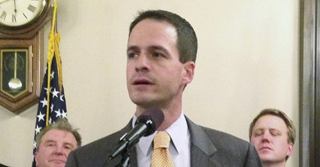 Michigan House to pay $515K in suit related to sex scandal