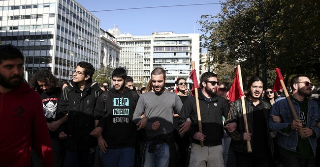 Greece hopes for debt relief as strikes hit services
