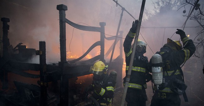 The Latest: France sending planes to help Israel fight fires