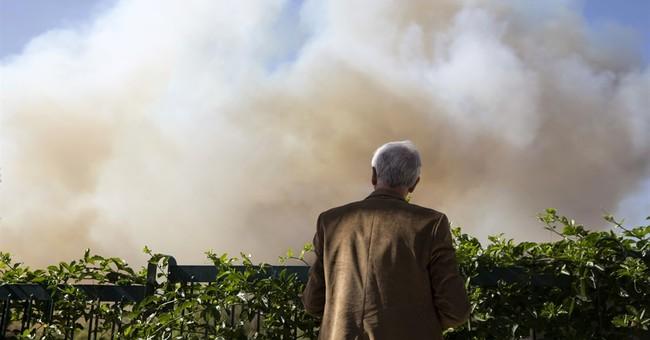 Wildfire blamed on 'terror' roars through Israeli city