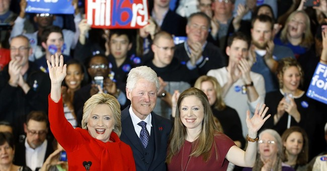 Clinton takes Iowa, beating back Sanders' strong challenge