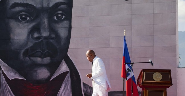 Song by Haiti's outgoing leader jeers at female journalist