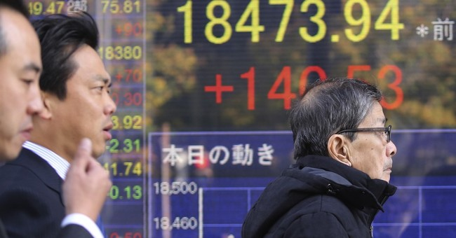 Global stocks turn lower in quiet trading after US holiday