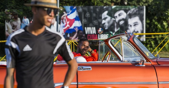 In Cuba, tourists find historic moment and limited options