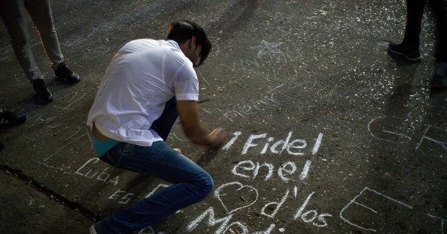 The Latest: Mexicans gather outside Cuban embassy to mourn