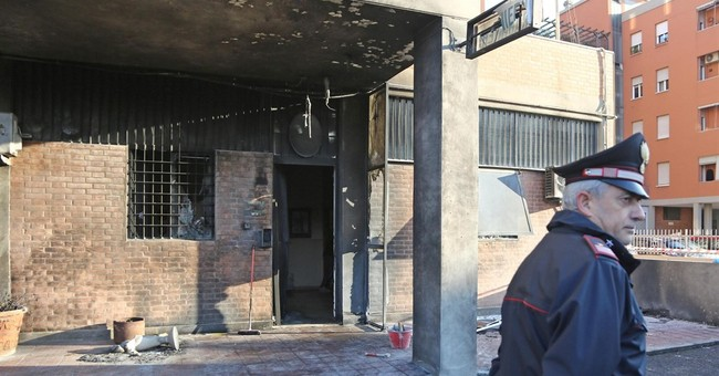 Gas canisters detonated outside Italian police station