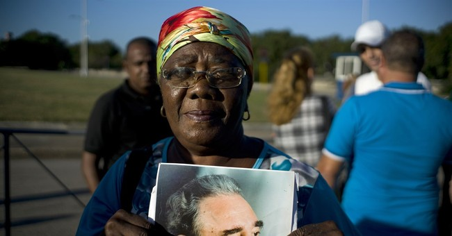 The Latest: Cubans line up to sign oath to revolution